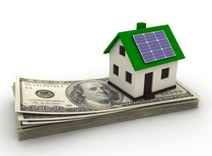 house with solar panels on roof, sitting on a stack of money
