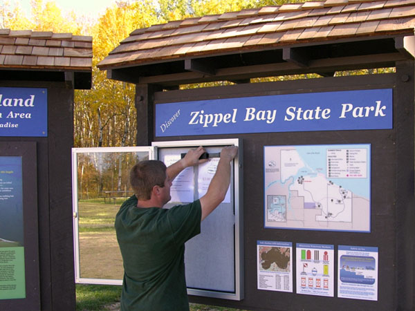 DNR employee updates park sign