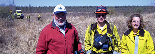 private lands specialists assisting landowners with prescribed burn