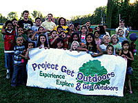 group of people holding Project Get Outdoors banner