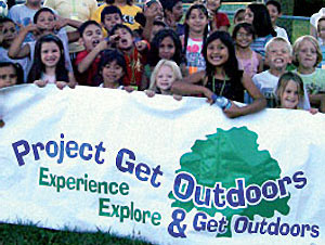 group holding Project Get Outdoors banner