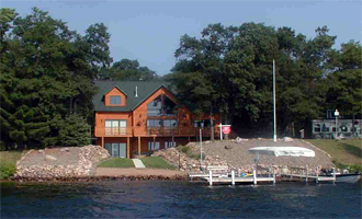 large home on heavily developed lake lot