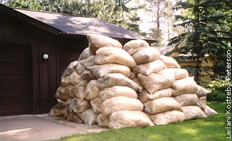 bags of mulch stacked next to the Streetar home