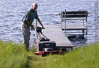 Ray Wagner mowing walking path to the dock
