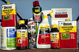 bottles, boxes, cans and tins of lawn chemicals