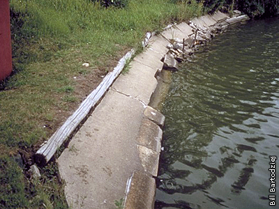 lake with concrete retaining wall