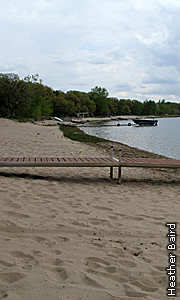 sandy shore with dock