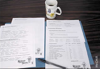restore your shore worksheets in open folder with pen and cup of coffee