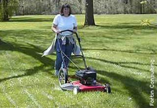 person mowing large lawn
