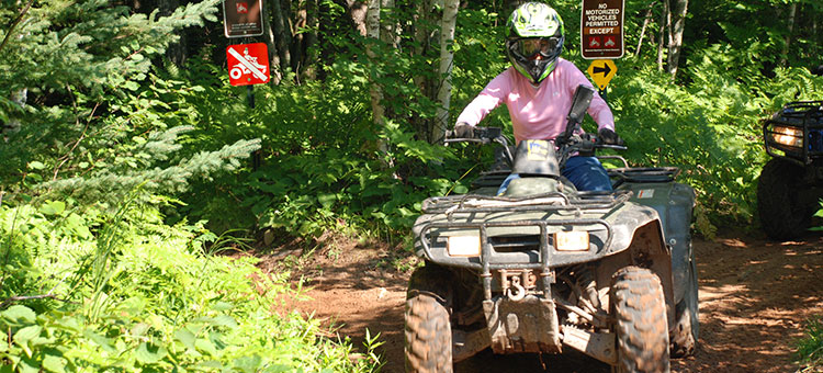 woman riding an ATV