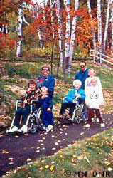 A group with physical disabilities using an accessible trail.