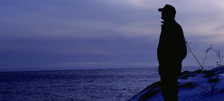 Volunteer silhouette overlooking lake, Visit the Wild Places
