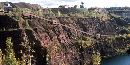 Photo of the mine equipment and structures along a cliff face.