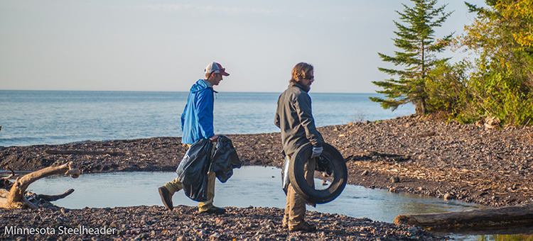 Volunteers removing tires from a river