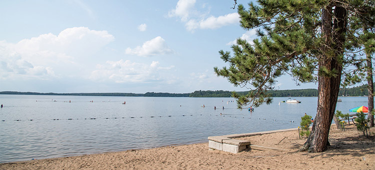 Photos of people enjoying beaches at Minnesota State Parks and Trails