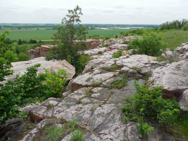Photo: The rock outcrops that rise above the prairie create the backbone of Blue Mounds State Park.