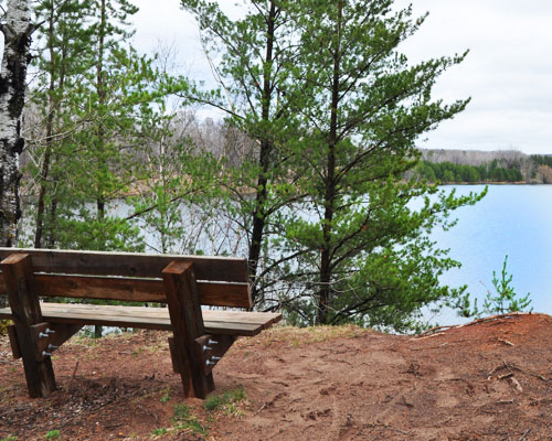 Bench on hill overlooking lake