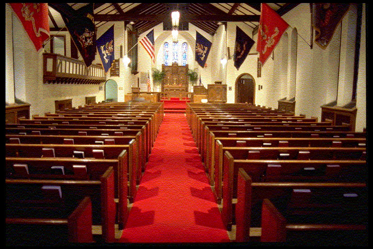 Interior of Fort Snelling Memorial Chapel aisle and pews.