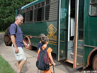 Visitors boarding bus for historic mine tour.