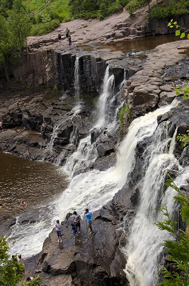 Visitors enjoy a view of Gooseberry Falls.