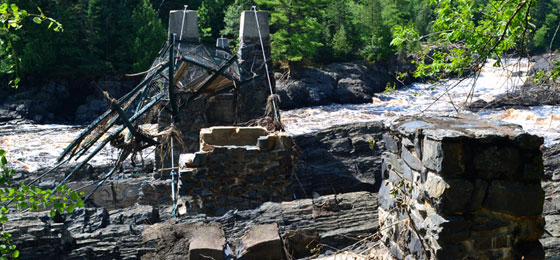 Photo of the swinging bridge at Jay Cooke State Park after the 2012 flood damage