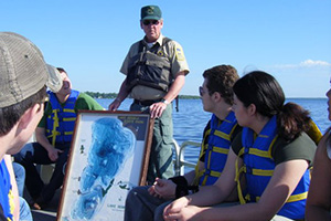 Photo of a naturalist led lake tour on the pontoon boat.