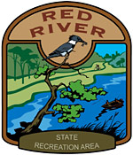 Red River State Recreation Area logo showing king fisher sitting in a tree along the river.