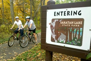 Photo of bikers traveling from state trail to state park.
