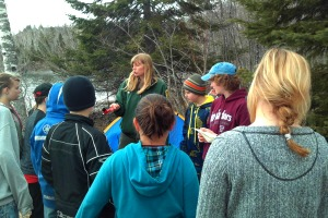 Photo of park visitors listening to an interpretive program given by a park naturalist.