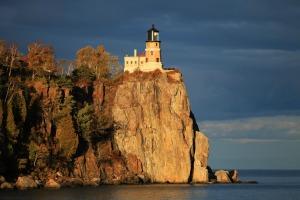 Photo of the Split Rock Lighthouse, perched on a rocky coast.