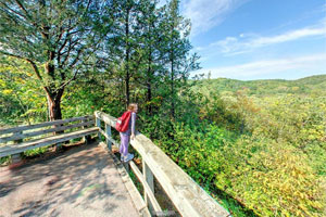 Photo of a child leaning across the railing at the spectacular overlook 300 yards from the main parking lot.