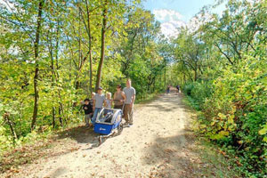 Photo of a family enjoying a walk along the trail that runs from the parking area to the lower picnic area.