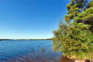 Photo of Bear Head Lake under a bright blue sky.