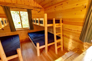 Photo of the interior of one of the five camper cabins.