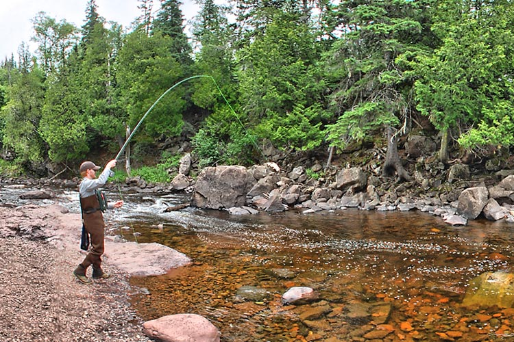 Photo of angler fly fishing on the Cascade River.