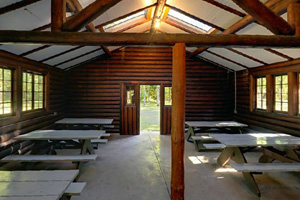 Photo of the interior of the park's picnic shelter building.