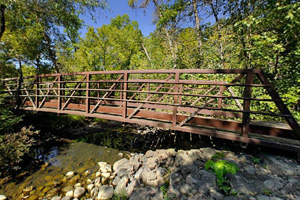 Photo of a footbridge crossing Pike Creek.