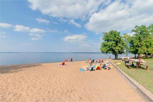 Photo of swimming beach at Father Hennepin State Park.