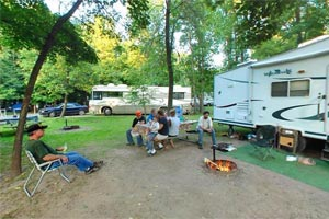 Photo of trailers and RVs set up at Father Hennepin State Park's very popular Lakeview Campground.