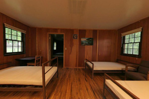 View of cabin interior beds and desk.