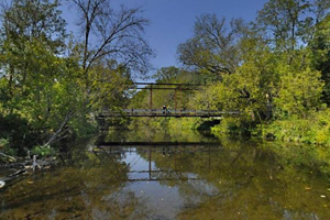 Photo of the 1899 bridge providing access to (North) Historic Forestville, a state historic site.
