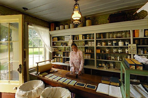 Photo of a costumed tour guide inside the 1857 Meighen General Store.