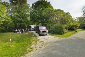 Photo of visitors enjoying a campsite.