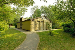 Photo of the park campground's toilet and shower facility along a paved path.