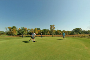Photo of the golfers playing on the park's golf course.