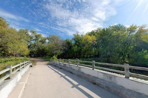 Photo of the biking and walking path that crosses the river.