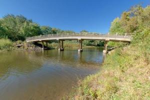 Photo of the Pike Island Bridge within the floodplain.