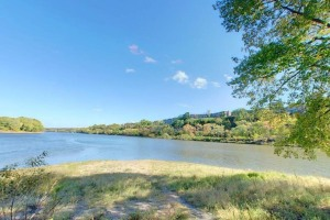 Photo of the confluence as the Mississippi and Minnesota Rivers merge, as viewed from Pike Island.