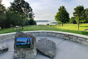 River bluff overlook photo displaying a plaque about the area's history.