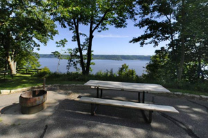 Photo of an accessible picnic site near a trail that offers a pretty view of Lake Pepin.
